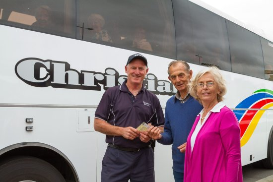 Tom Hogan preparing passengers to board the bus for a Melbourne Day Trip out of Ocean Grove