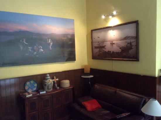 Casona Rosa: Living room/library area w/ photos by artist Jesus Alexandre Arts on Facebook