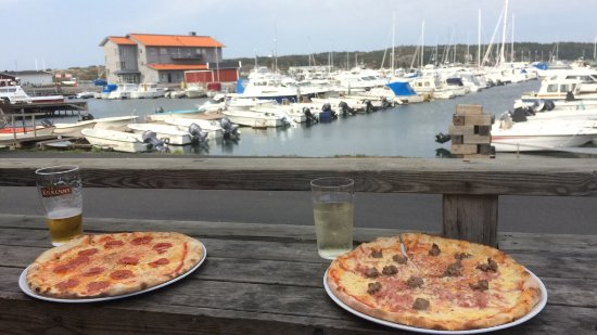 Donso, Sweden: Pepperoni pizza and Capri pizza - picture taken from their outside deck overlooking the marina.