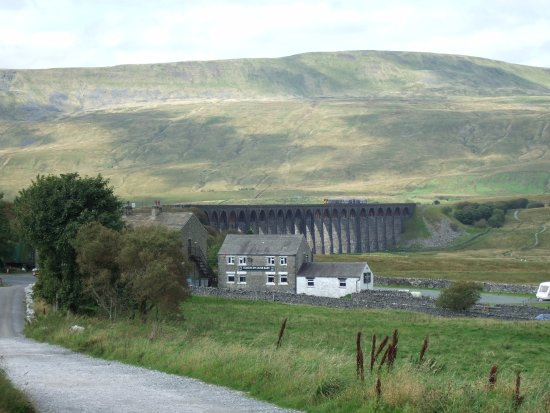 Ingleton, UK: Ribblehead Viaduct with Whernside peak as backdrop, from Ribblehead Station car park