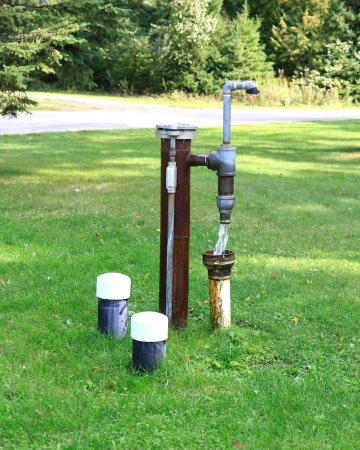 Bark River, MI: Artesian well at site #10.