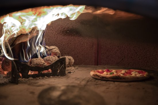 Ulverston, UK: Enjoy an authentic wood-fired pizza like this one cooking in our oven...