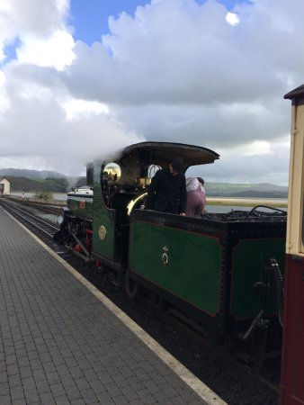 Porthmadog, UK : The steam engine setting off on its journey.