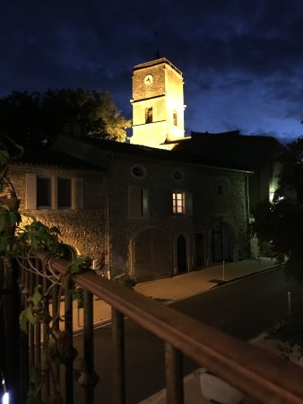 View on the churchtower of Goult from restaurant La Terrasse