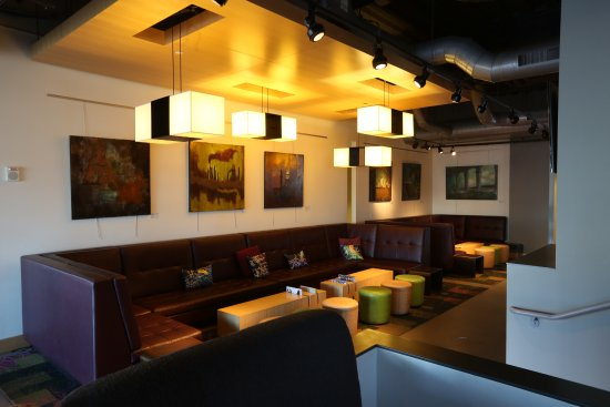 Aloft Cleveland Downtown: Bar sitting area. The bar is in front, it's pretty cool i did not take a pic sorry.
