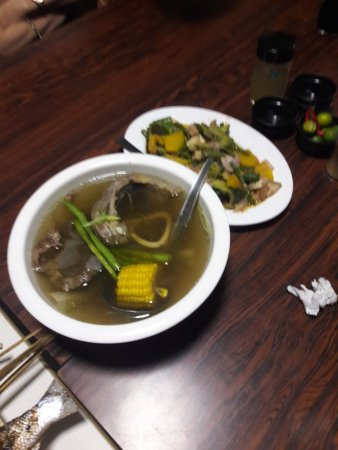 Caloocan, Philippines : Beef soup and Bitter melon (Ampalaya) dishes
