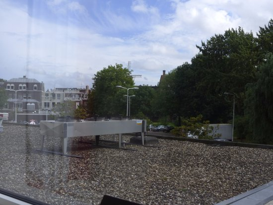 Ibis Leiden Centre: view out of window over shop and the car park