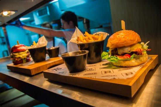 Bishops Stortford, UK: 2 Burgers ready to go, One beetroot brioche with Nigella seeds.