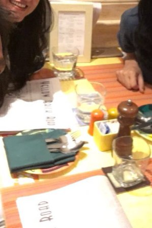 Table setting with newspaper menu - Picture of yellow brick cafe ...