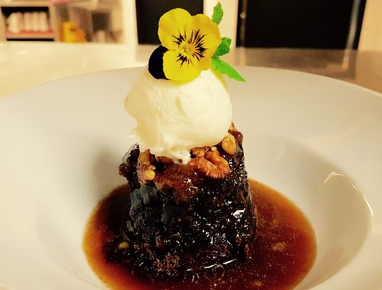 Invermere, Canada: sticky date toffee pudding with vanilla ice cream and candied walnuts