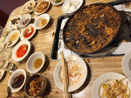 Dong Il Jang Restaurant: This is what the table looked like after the last entree of stir fried rice was consumed.