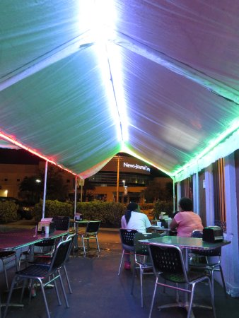 side patio seating under the tent picture of tia coris tacos