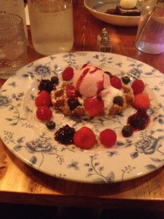 Yorkshire, UK: Warm waffle topped with strawberry ice-cream and mixed berries.....gorgeous!!!