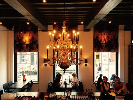 Photo of Restaurant Stuyvesant Wijnlokaal at Haarlemmerstraat 75, Amsterdam 1013 EL, Netherlands