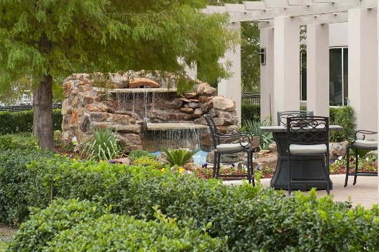 Irving, TX: Patio with Firepits and Waterfall