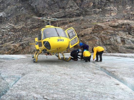 Above & Beyond Alaska: Taking off crampons before flying back to Juneau
