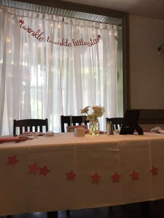 The Lederach Tea Room: A head table set up for mom-to-be with twinkling backdrop