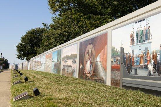 Floodwall Murals: Looking down the wall of murals