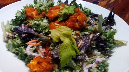 Livonia, MI: CRISPY BUFFALO CHICKEN SALAD crispy buffalo chicken tenders/mixed greens/kale/bacon/red onions/g