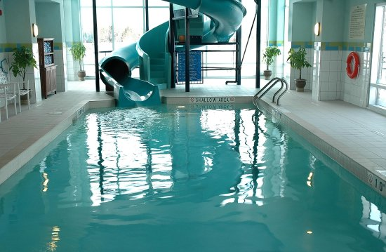 Indoor pool with waterslide  Indoor Pool Waterslide - Picture of Hampton Inn & Suites by Hilton ...