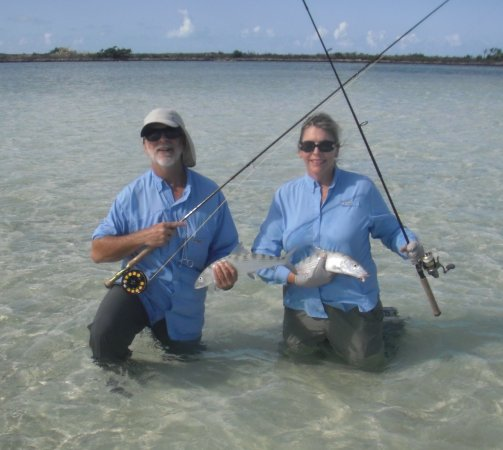 Acklins Island: Mel and I with a double. These were the smallest fish caught but special as I had us both hook u