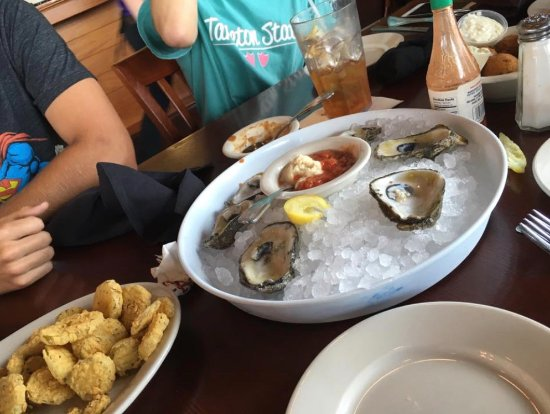 Spanish Fort, AL: Oysters on the half shell - Yummm. Fried pickles.