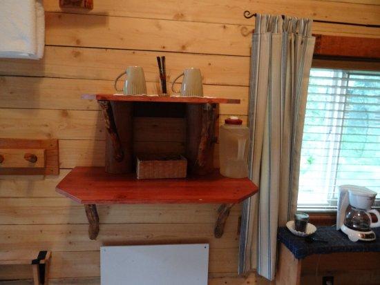 Alaska Creekside Cabins: heating element under shelf