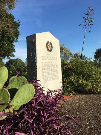 Goliad, TX: Native plants beautifully frame the historical marker stone