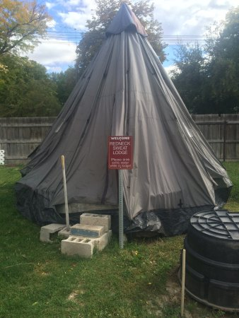 zoom in on the sign redneck sweat lodge a tent over a small hot