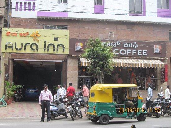 Aura Inn: Hotel entrance from Rajkumar road and My coffee shop.