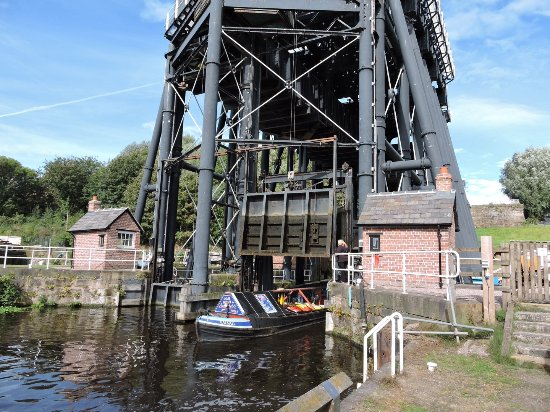 Northwich, UK: Working barge emerging from the lift