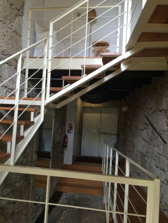 Casa dos Guindais: The bright central stairwell and the front door (at back)