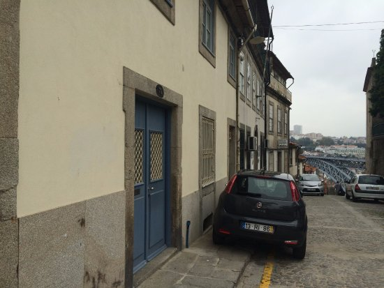 Casa dos Guindais: The front door and the street outside, where steps lead down to the river.