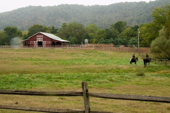 Max Meadows, VA: The horse barns and two Virginia State Park employees riding