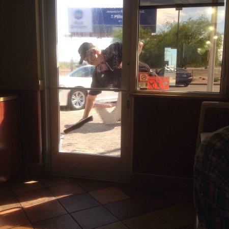 Gila Bend, AZ: An employee working hard to keep the premises clean