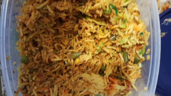 Earth Indian: Biryani rice without the ingredients listed on the take out menu.