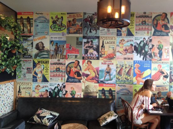 Narrabeen, Australia: Just inside cafe, great poster wall.