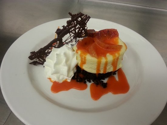 Kohler, WI: Cheese cake is always a choice on the dessert menu. This was a blood orange cheesecake special.