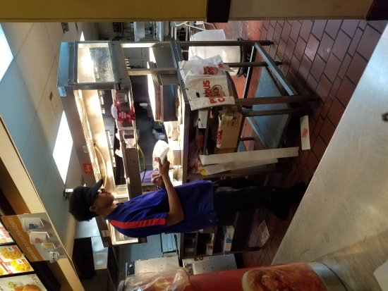 Des Moines, WA: Behind the counter and 1 of the staff members.