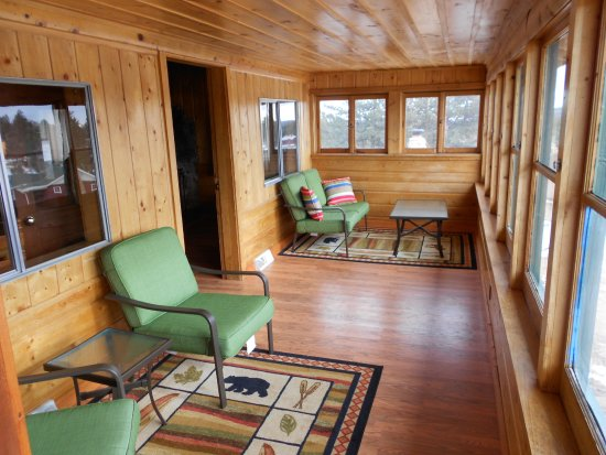 Elegant Log Cabin Sunroom
