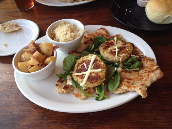 Paola, KS: Ingrid Schnitzel (with crab cakes and spinach plus warm german potato salad and kraut