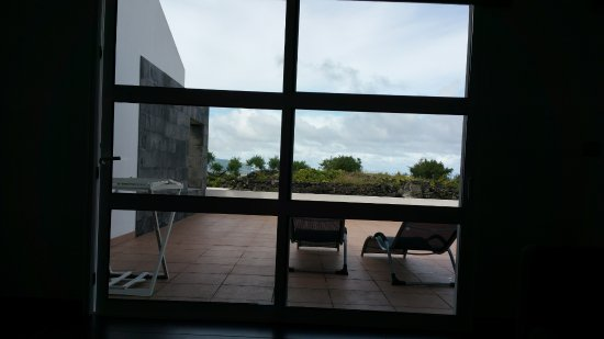 Jeiroes: View out the door over the patio to the ocean.