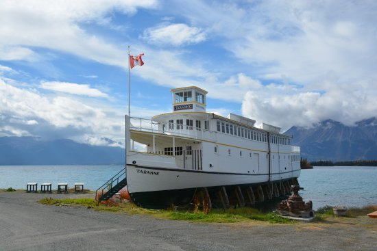 MV Tarahne lake boat on the shore of Atlin Lake