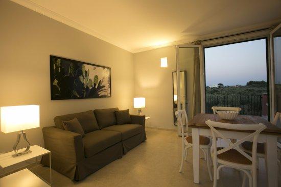 Soggiorno con divano letto - Picture of Corte Olea Resort, Paceco ...