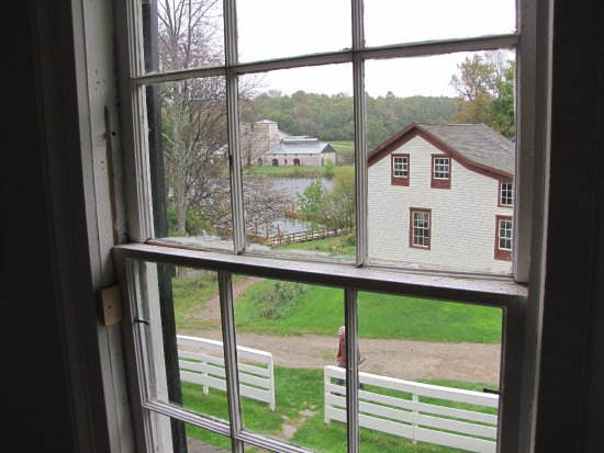 Garden, MI: View from upper storey window of the Superintendent's House. Jackson Iron Co. furnace in backgro