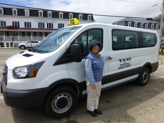"Block Island, RI: Owner Fran Migliaccio with the ""rig"": Mig's Rig Taxi."
