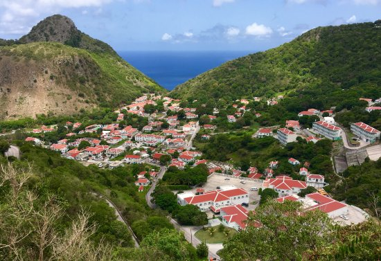 View of The Bottom from the only road in Saba. White houses with red roofs are required.