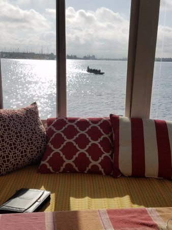 Barkissimo Floating Boat & Breakfast: View out the Breakfast nook window. Lots of rowing crews out in the estuary