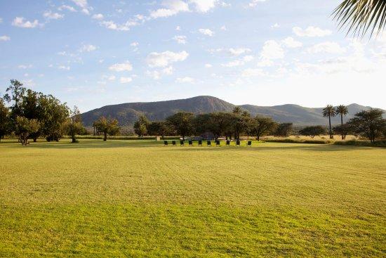 Tsumeb, Namibia: Large lawn of Ghaub Lodge in Ghaub Nature Reserve & Farm