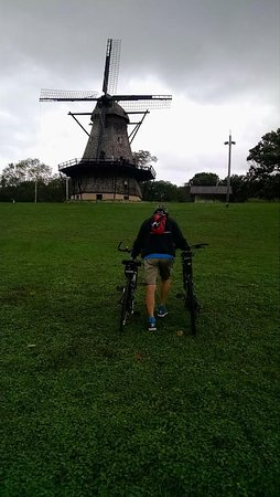 Batavia, IL: Walking our bikes up from the Fox River Trail to see the windmill.